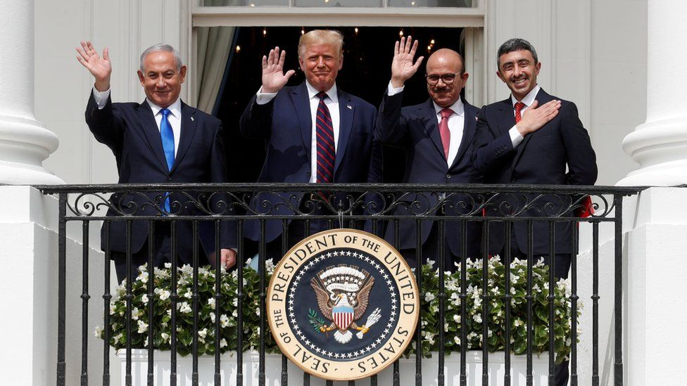 Israel's Prime Minister Benjamin Netanyahu, US President Donald Trump, Bahrain's Foreign Minister Abdullatif Al Zayani and United Arab Emirates Foreign Minister Abdullah bin Zayed wave from the White House balcony after a signing ceremony for the Abraham Accords (15 September 2020)