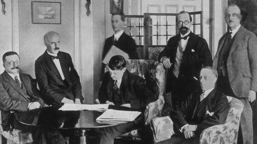 A delegation of Irish leaders including Michael Collins (centre) signed the Anglo-Irish Treaty in London in 1921, which led to the partition of Ireland