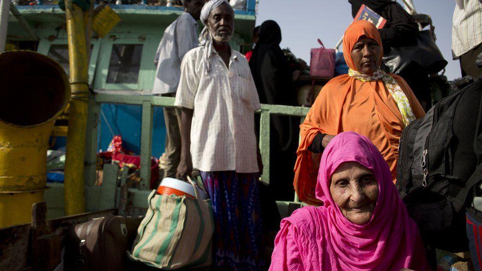 Elderly people waiting in a boat, Bossasso, Somalia