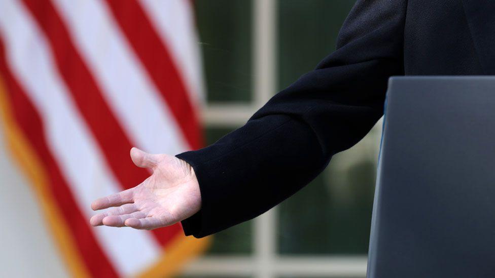 Trump's hand as he speaks in Rose Garden