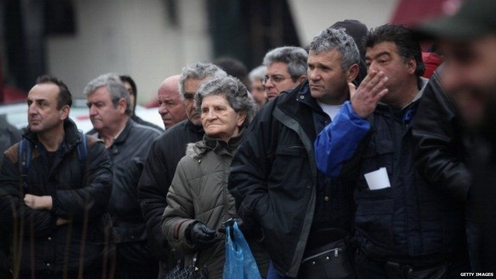 Members of the public queue to receive free food opposite Athens' Central Market in the Omonia district (February 2012)