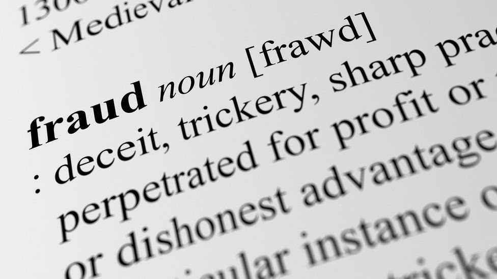 close-up of definition of fraud