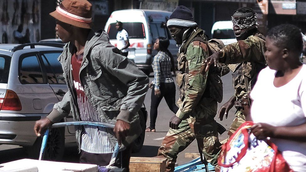 Soldiers gesturing to people in Harare, Zimbabwe - 2 August 2018