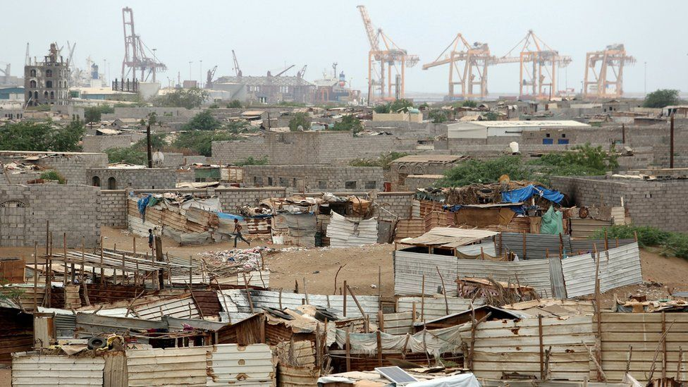 Cranes at Hudaydah's port are pictured near a shantytown (16 June 2018)