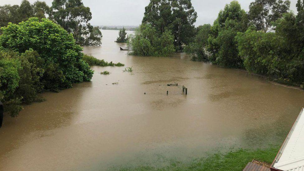 Floods engulf a backyard