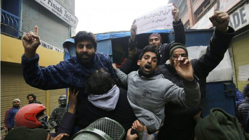 Activists of Kashmiri separatist groups shout slogans from police vehicle after they were detained during a protest march on Human Rights Day in Srinagar, the summer capital of Indian Kashmir, 10 December 2017
