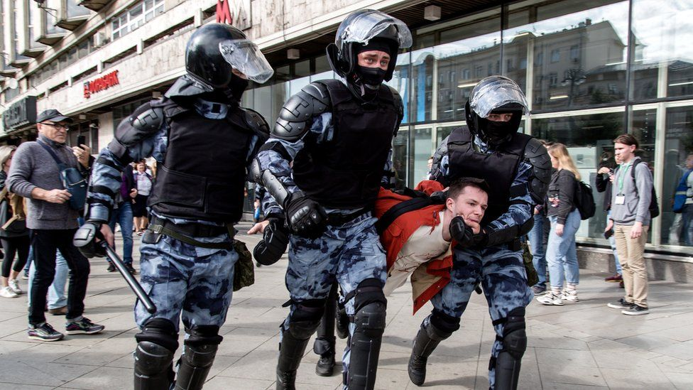 Police officers detain a man during an unsanctioned rally in the centre of Moscow, Russia, 3 August 2019