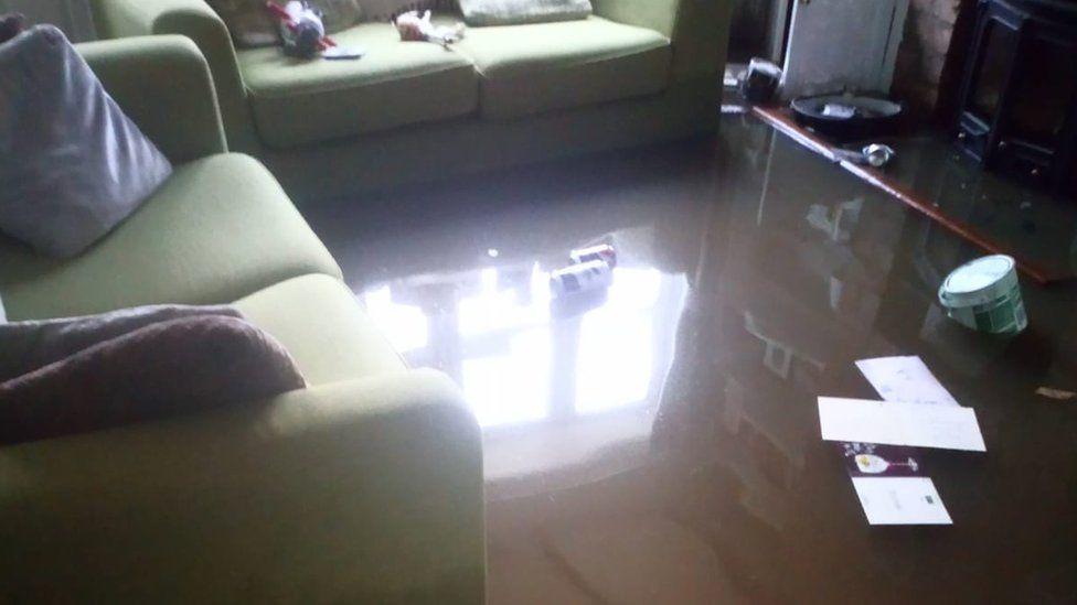 Flooding inside Beth Moore's cottage