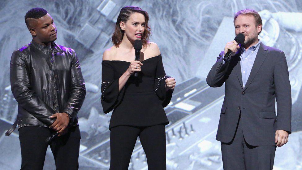 Rian Johnson (right) with John Boyega and Daisy Ridley