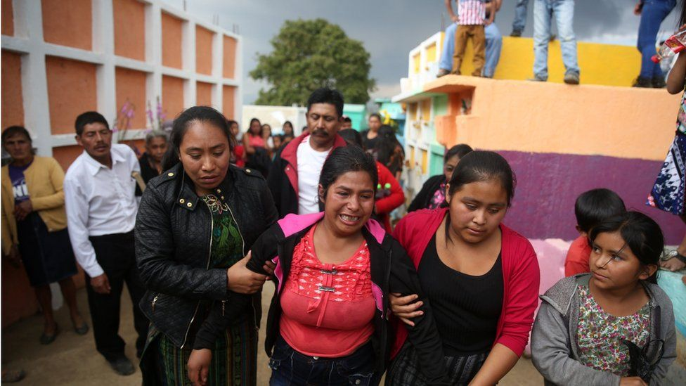 Gloria Perez (c) mourns her 14-year-old sister, Ana Roselia, who died in a fire at a Guatemalan children's home