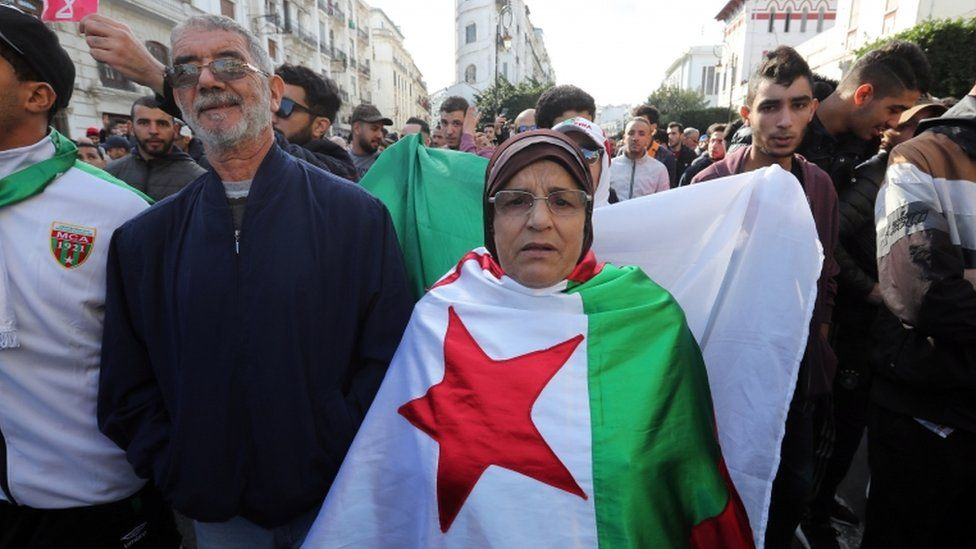 Algerians chant slogans during a protest rally in Algiers, Algeria, 12 December 2019.
