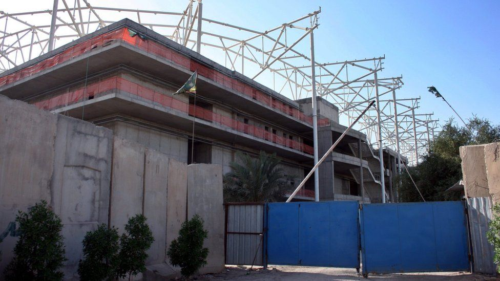 Entrance to a sports stadium under construction in Baghdad's Sadr City district (2 September 2015)