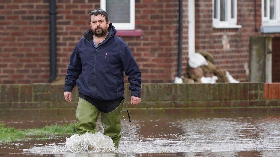 A man walks through flood water in East Cowick