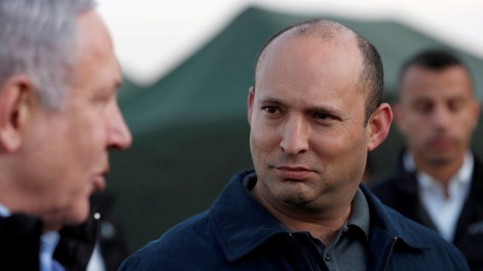 Benjamin Netanyahu (L) speaks to Naftali Bennett (R) during a visit to an Israeli army base in the occupied Golan Heights (24 November 2019)