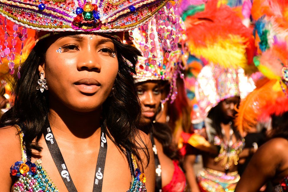 A young woman in a brightly coloured headdress