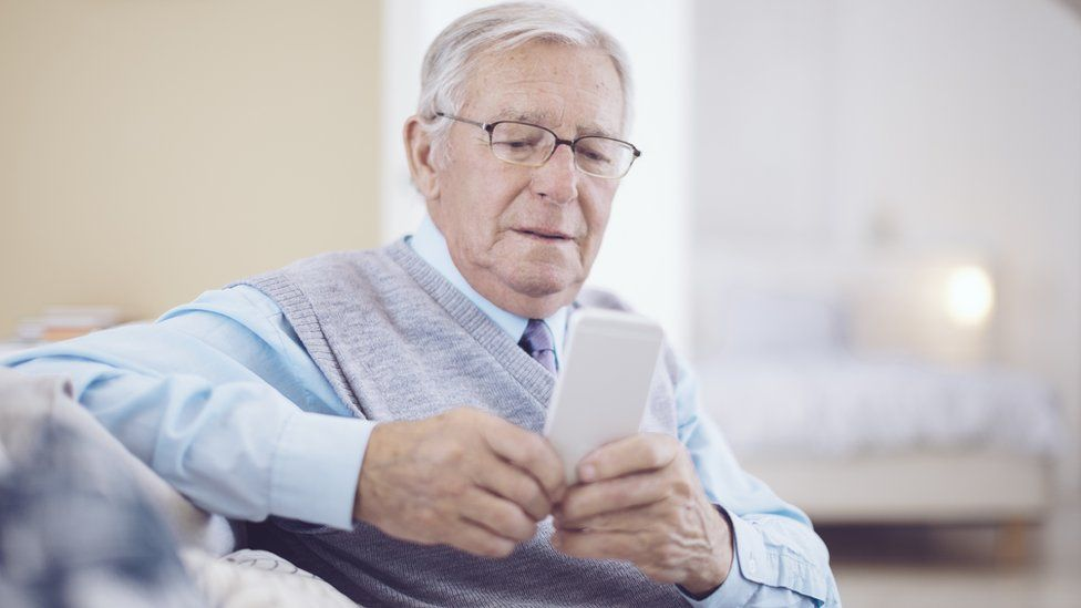 Older man using a smartphone