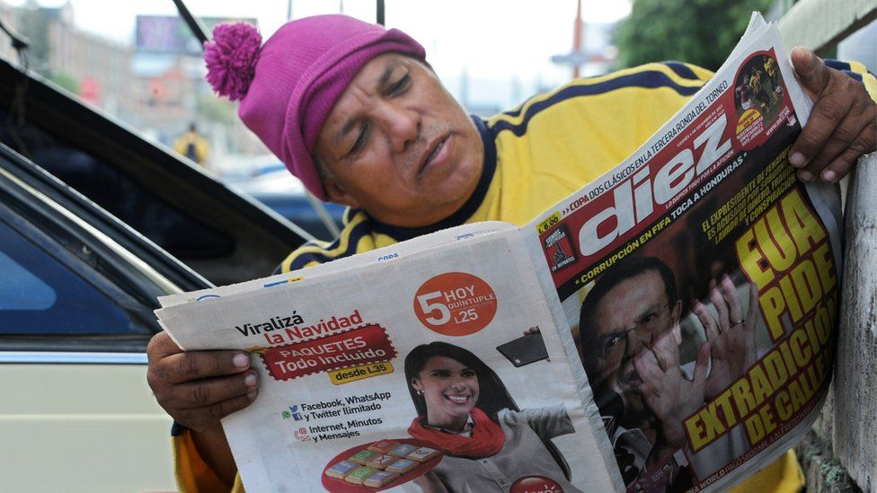 Man reading newspaper in Honduras