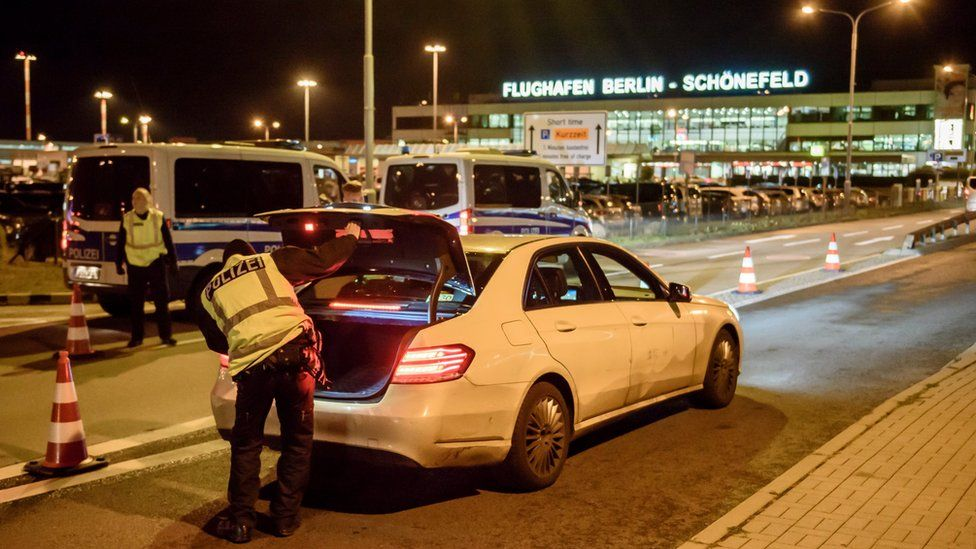 Police check arriving cars outside Schoenefeld Aiport near Berlin following the launch of a manhunt for a terror suspect
