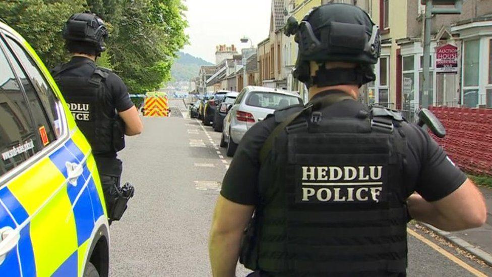 Armed police at the scene in Swansea