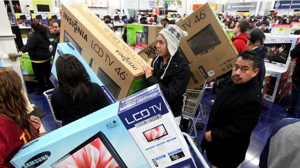 Customers shop for electronics items during 'Black Friday'.