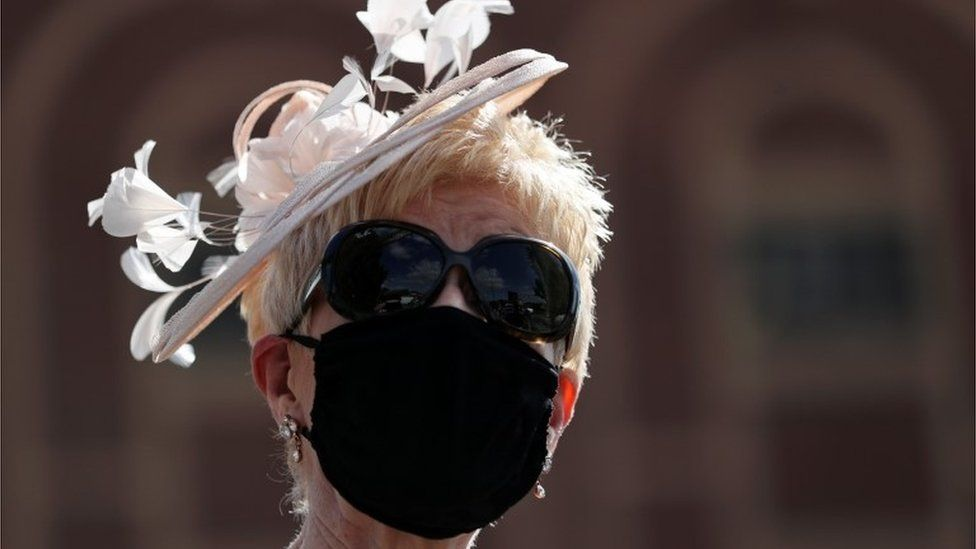 A woman wearing a face mask at Doncaster Racecourse