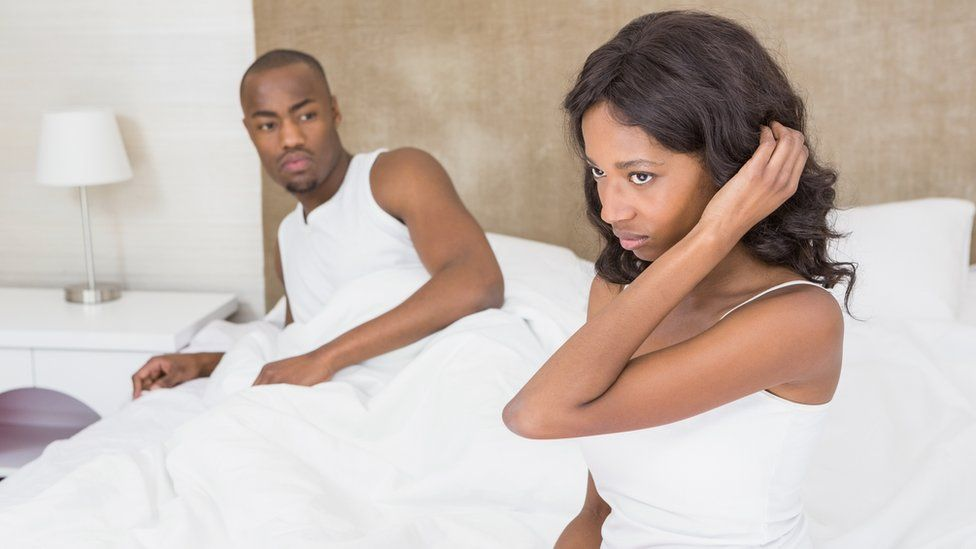 Couple arguing on their bed