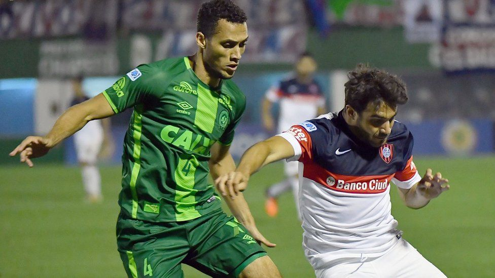 Neto of Brazil's Chapecoense vying for the ball with Ezequiel Cerutti of Argentina's San Lorenzo, during their 2016 Copa Sudamericana semifinal second leg football match on 23 November