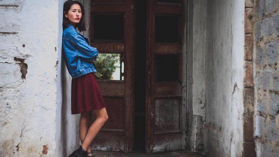 Aliya Shagieva portrait in a doorway