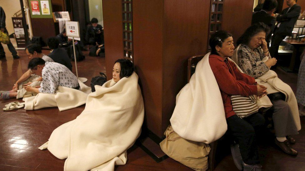 Hotel guests gather at the lobby after another earthquake hit the area in Kumamoto.