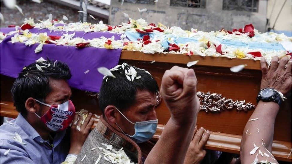 """Friends and family members carry the coffin holding the body of Inti Sotelo, who died in clashes following the ouster of Peru""""s President Martin Vizcarra, in Lima, November 16, 2020."""