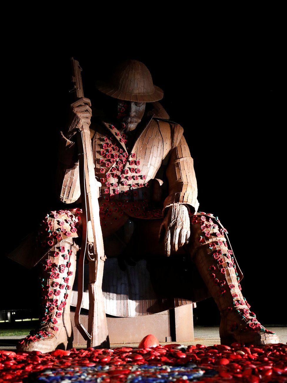 """The historical statue of soldier """"Tommy"""" on Seaham seafront in County Durham is decorated with magnetic poppies"""