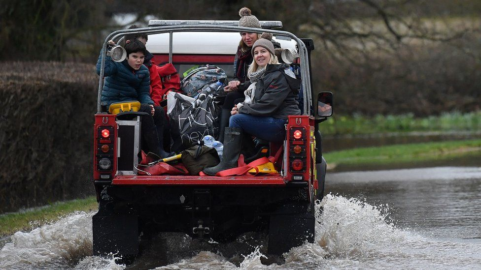 Fire and Rescue 4x4 vehicle driving through floods near Hereford