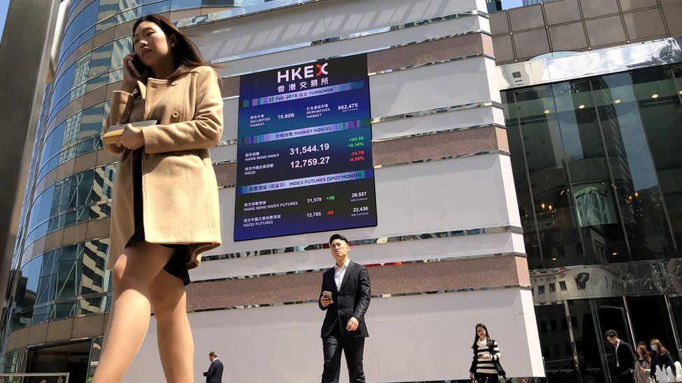 A billboard on the front of the building shows the stock market trends for the different companies listed on February 27, 2018 in Hong-Kong, China.