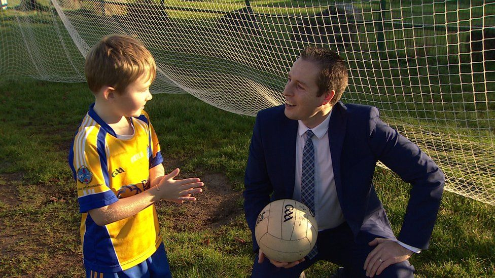 A keen soccer player, it was the first time the sports minister had kicked a Gaelic football