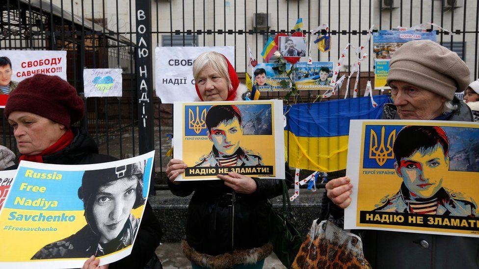 Women holds posters depicting Ukrainian pilot Nadiya Savchenko outside the Russian Embassy in Kiev, Ukraine, Tuesday, 22 March 2016