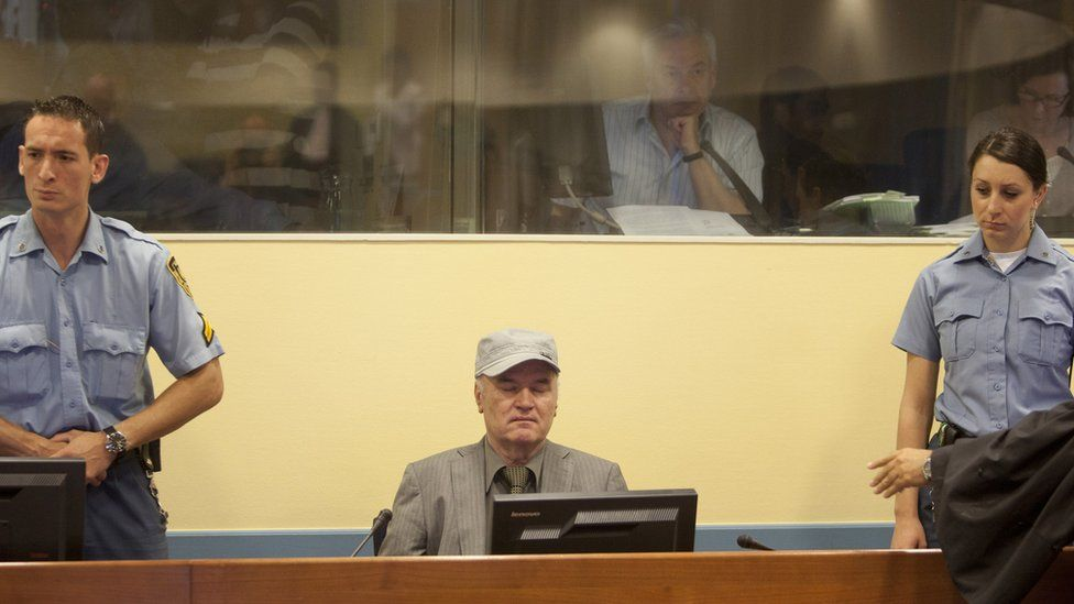 Former Bosnian Serb military leader Ratko Mladic takes his seat in the International Criminal Tribunal to face war crime charges on June 3, 2011