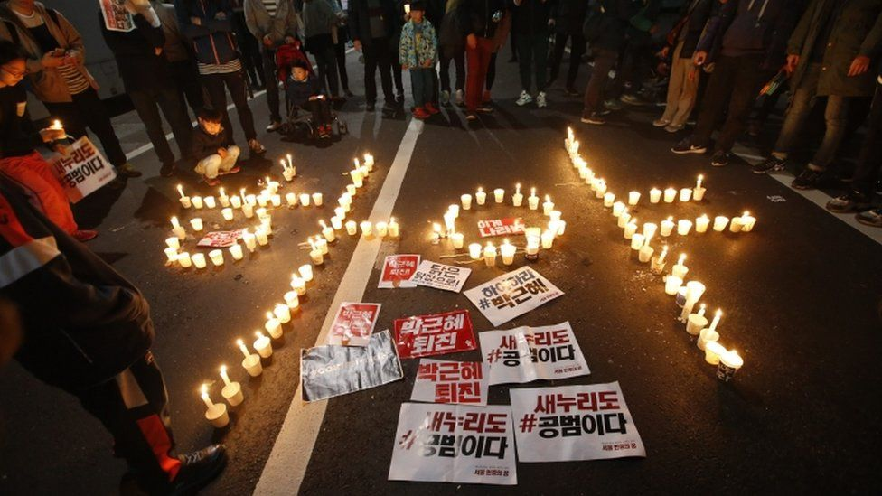 """Candles spell out """"President Park Geun-hye Step Down"""""""