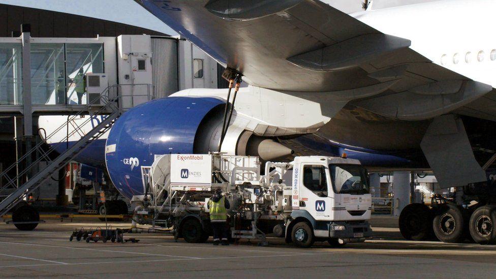 Plane being refuelled