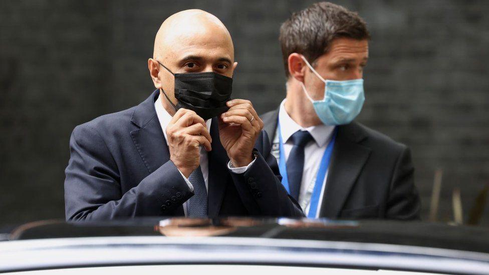 Health Secretary Sajid Javid adjusts his face mask as he leaves Downing Street