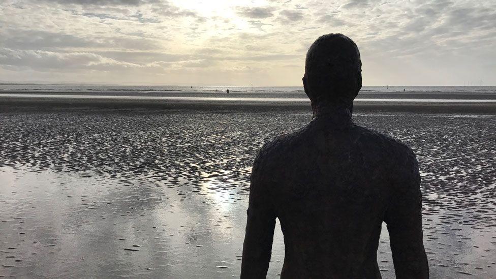 Iron statue on beach