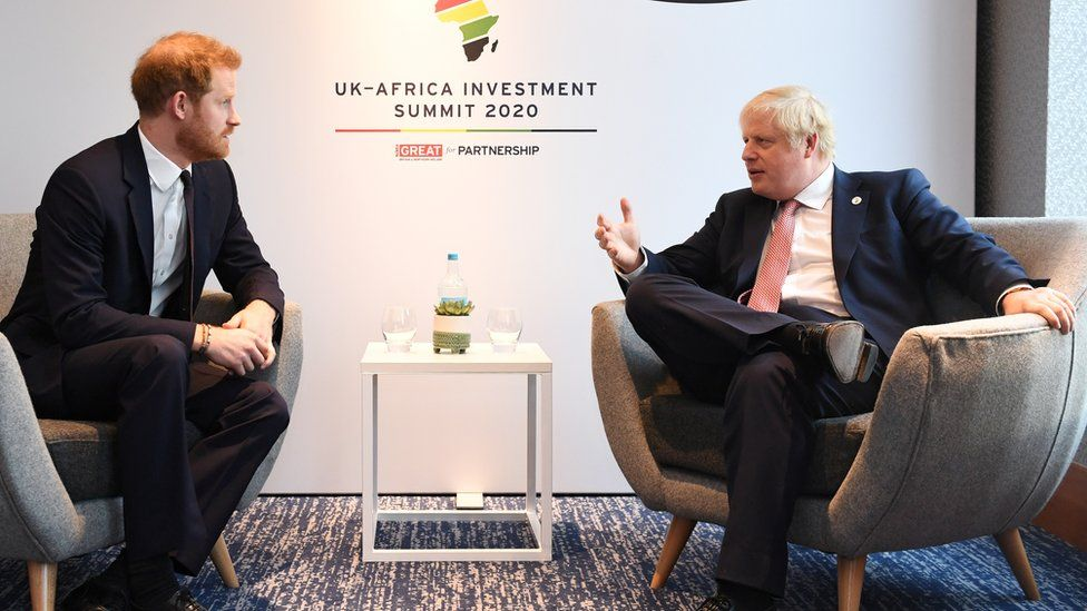 Prince Harry talks to Prime Minister Boris Johnson during the UK-Africa Investment Summit in London