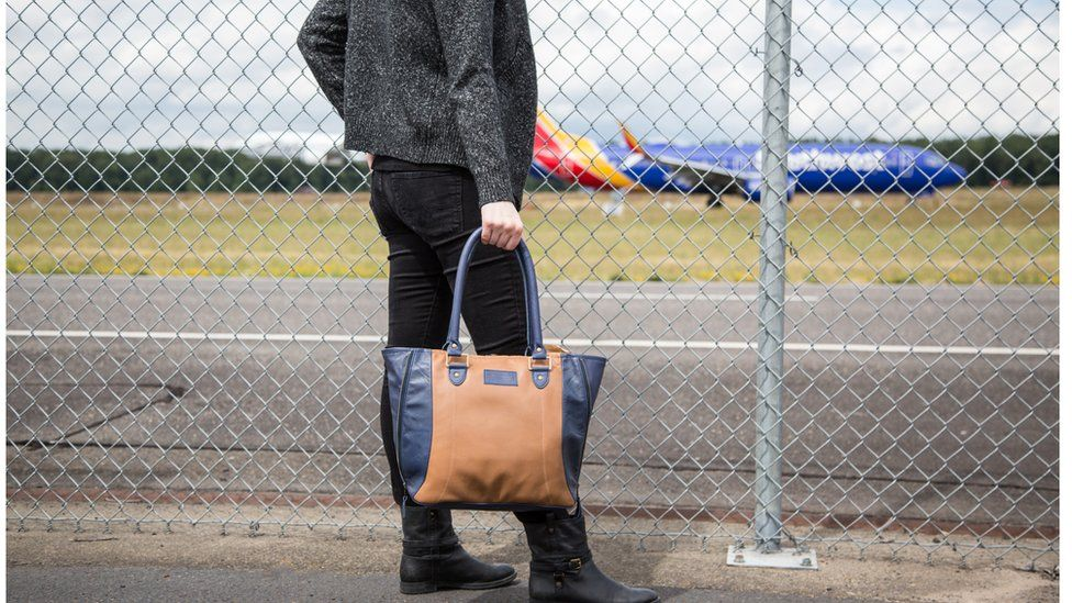 A handbag upcycled from airplane seat leather