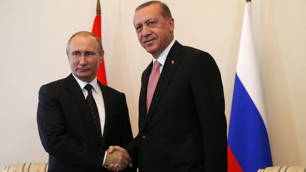 President Vladimir Putin (left) shakes hands with Turkish counterpart Recep Tayyip Erdogan in St Petersburg