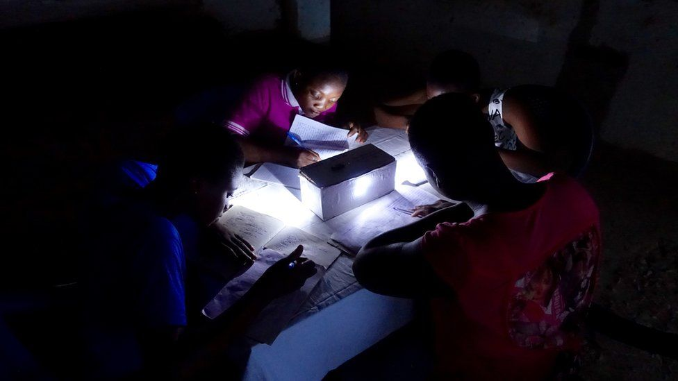 Children at home using the science kit to help them do their homework