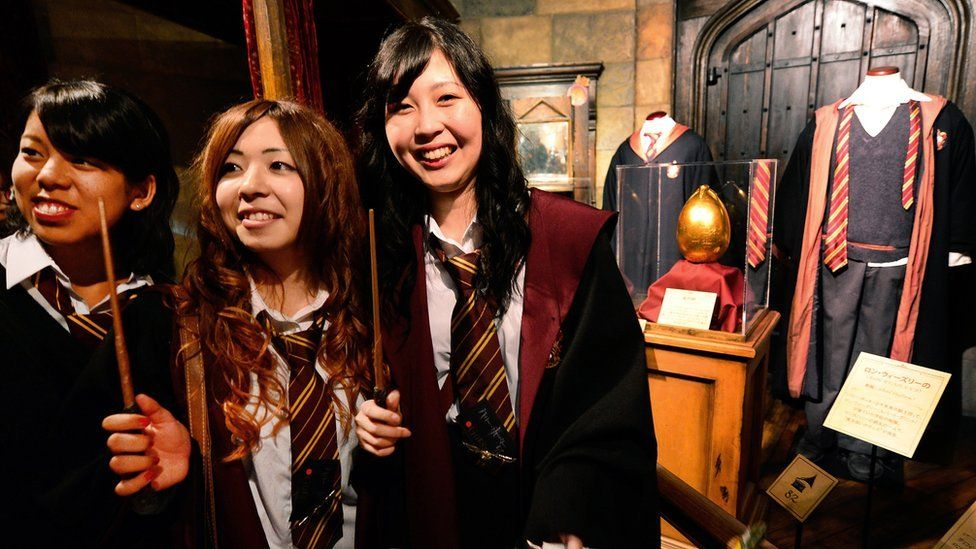 Fans in Harry Potter uniforms