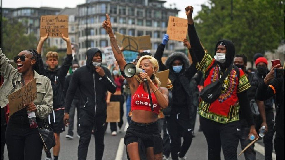 People marching to Victoria Station from Hyde Park during a Black Lives Matter protest rally in London