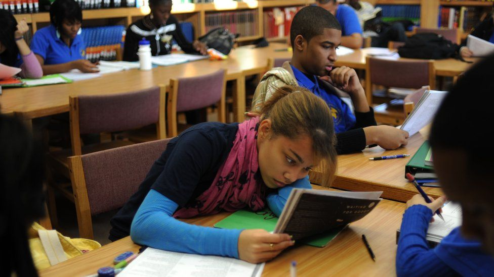 Student revising at Bronx International High School