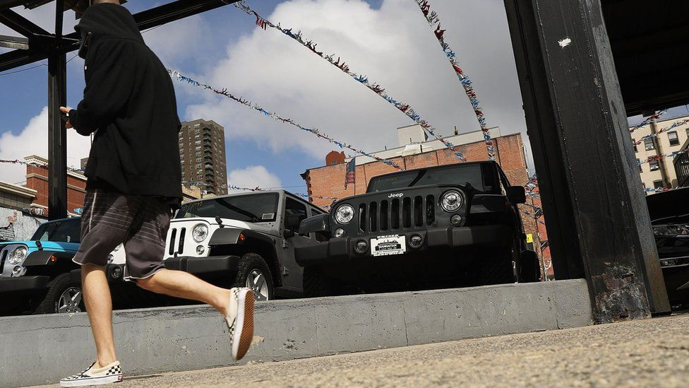 Jeep Wranglers are displayed at a Manhattan Fiat Chrysler dealership on July 23, 2018 in New York City.