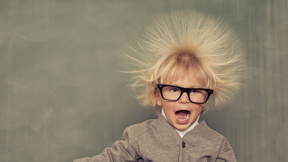 A boy with his hair standing on end (showing static electricity)
