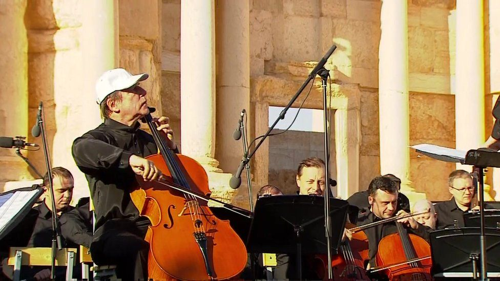 Cellist Sergei Roldugin performing at the concert in Palmyra on 5 May 2016